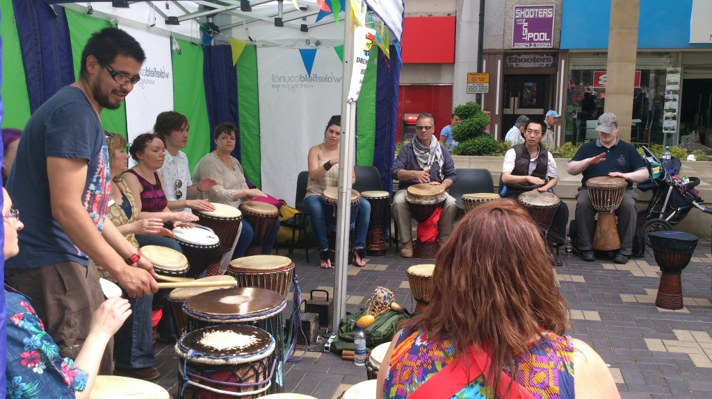 One of our outdoor drumming workshops – people come to play, learn or simply have a good time!